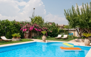Swimming pool in a flower garden with mattresses